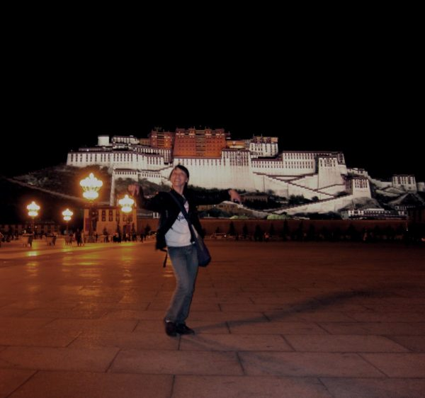 Lhamo dancing in Lhasa, in front of the Potala Palace