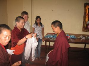 Steve and Choying, at her school, Choying handing out a ceremonial scarf