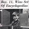Steve Tibbetts, age 11, with the books he won